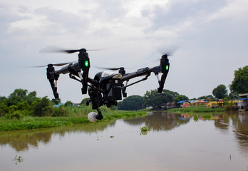 Professional camera drone flying on river and sky