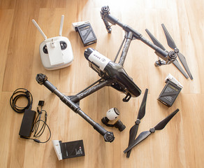Professional camera drone with remote control, battery, propeller, charger and camera.