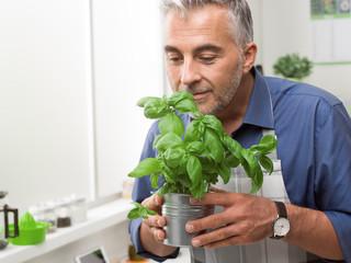Man holding a basil plant