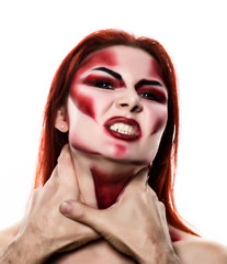 Beautiful sexy devil girl with professional make-up. Fashion Art design. Attractive model girl in Halloween make up