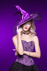 Beautiful woman, blonde in a good witch costume on a purple background. Costume party, young girl. Halloween