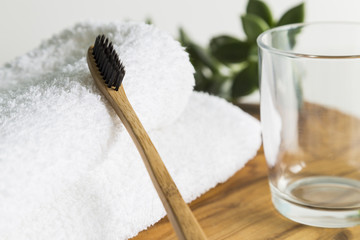 Bamboo toothbrush with towel and glass