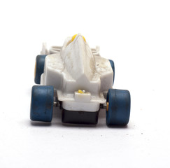 old children's racing car on a white background/old race car/isolated objects,toys