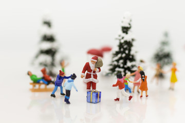 Miniature Santa Claus and Snow man make happy hour for children on Christmas day