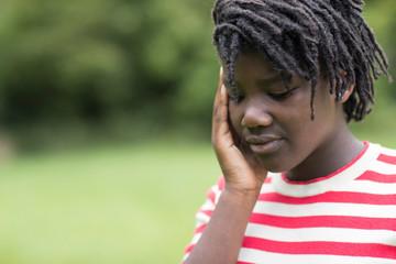 Outdoor Shot Of Stressed Teenage Girl