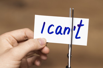 I can self motivation - cutting the letter t of the written word I can't so it says I can