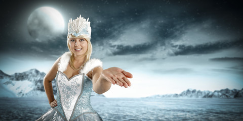 Ice queen woman and winter landscape