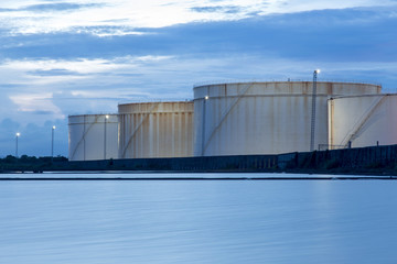 oil storage tanks with blue sky and clouds