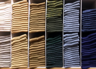 Stack of Various Color Clothes on Shelf