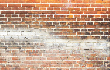 red old brick wall with graffiti divorces