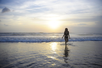 young active woman on sea landscape sunset horizon with amazing sun and dramatic orange sky