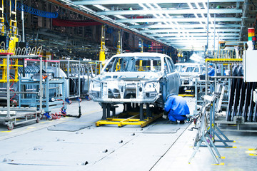 car production line, workers are working.
