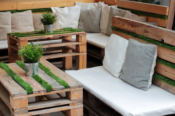 The tables and sofas of wooden pallet and grass