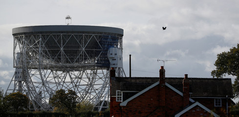 The Lovell Radio Telescope at the Jodrell Bank Observatory ,which has been selected as the latest  British candidate for World Heritage status, towers above a cottage in Jodrell Bank