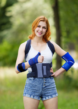 girl in an orthopedic corset for the back