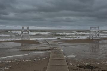 Lifeguard stands facing rough waves