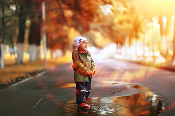 little girl on an autumn walk in the park