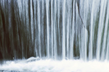Waterfall close up, blur and foam, nature background Wall mural