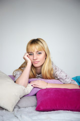 Young beautiful girl resting on the bed
