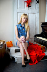 Lonely beautiful girl posing in studio