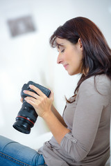 woman review photographs on the camera screen