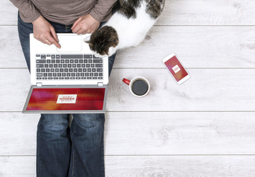Top View Mockup of Laptop and Smartphone User with Cat