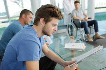 young man hospital waiting room