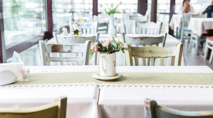 Restaurant table decorated with flowers