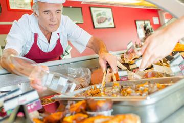 butcher serving customer