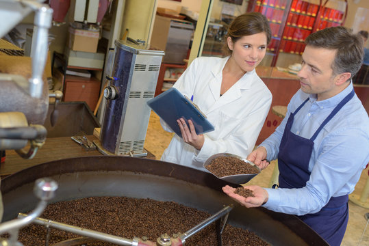scientist taking notes on the process of roasting coffee beans