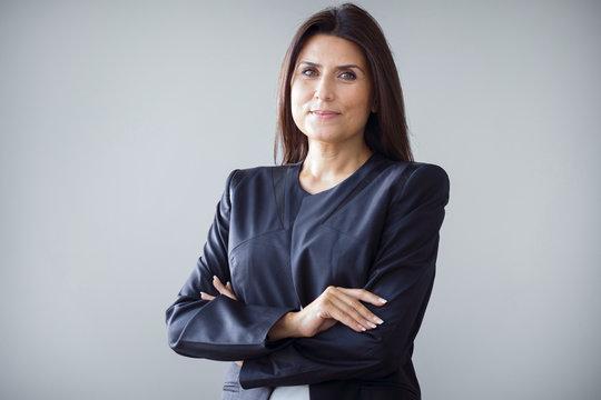 Portrait of businesswoman on grey background