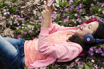 Girl Primroses Pink Headphones Phone Smiling