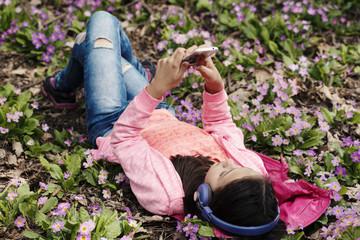 Preteen Girl Laying Primroses Wood Headphones