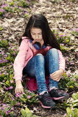 Sad Girl Primroses Sitting Ground Headphones Outdoors