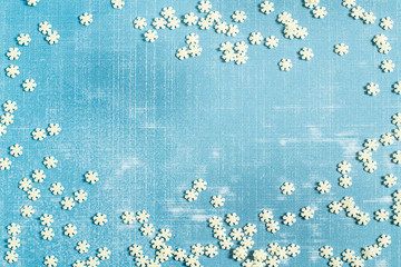 Christmas background with sugar decoration in form of snowflakes