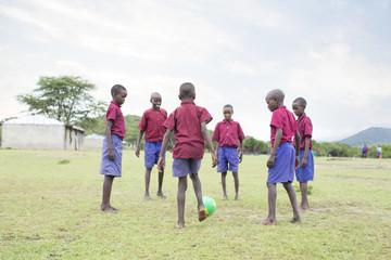 Schoolboys playing football. Kenya