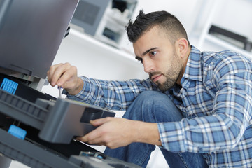 man fixing electronic circuits