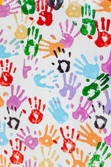 Colourful Handprints On A  White Wall