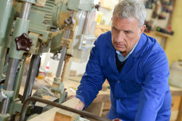senior worker on plant on production