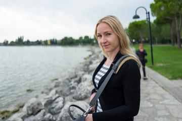 smiling blonde girl at lake Garda