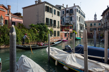 Gondola with tourists in Venice