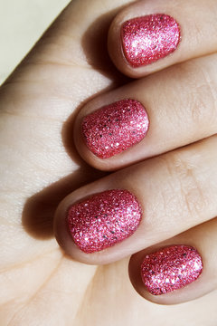 pink sparkling shiny nails closeup