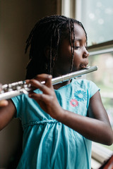 African American girl playing a flute