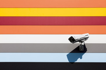 video camera on wall with colorful stripes