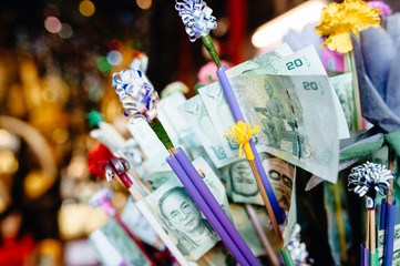 Banknotes as Decoration and a Donation in a Buddhist Temple in Thailand