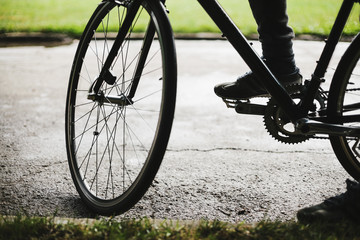 Detail shot of ciclyst and his bike