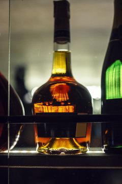 bottle of alcoholic beverage on the bar shelf