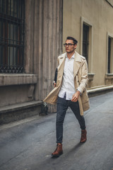 Young Business Man Walking in the Street.