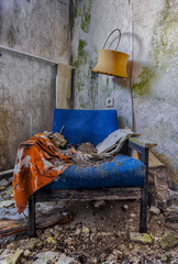rotting blue chair