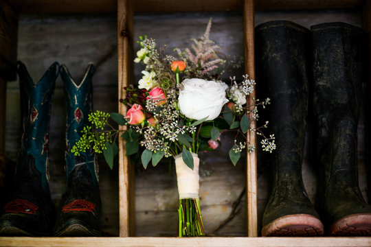 Cowboy boots and a bouquet